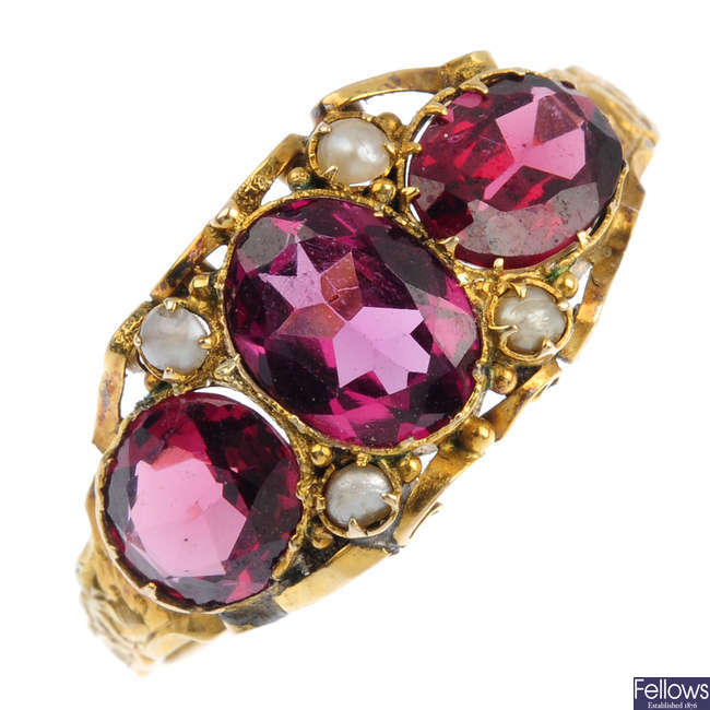 A mid Victorian 12ct gold garnet and seed pearl three-stone ring.