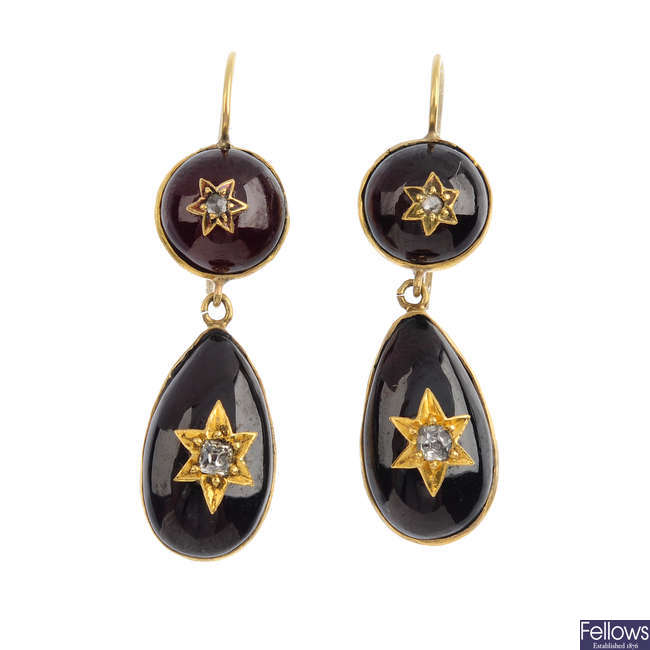 A pair of late 19th century garnet and diamond earrings.