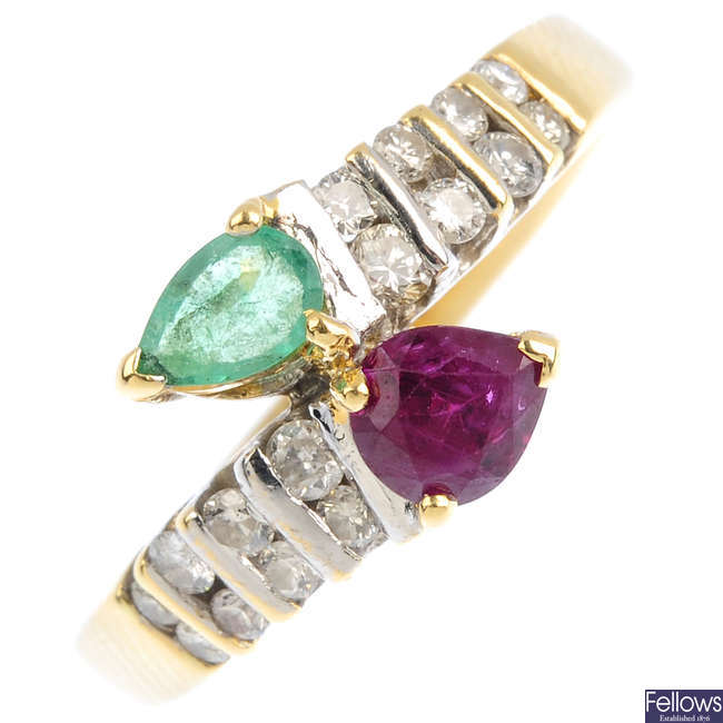 An 18ct gold ruby, emerald and diamond crossover ring.
