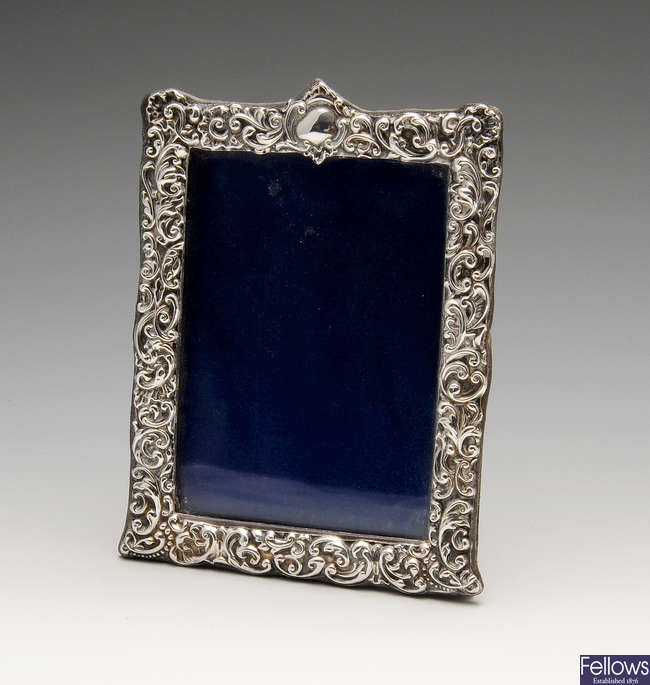 A late Victorian silver mounted photograph frame.