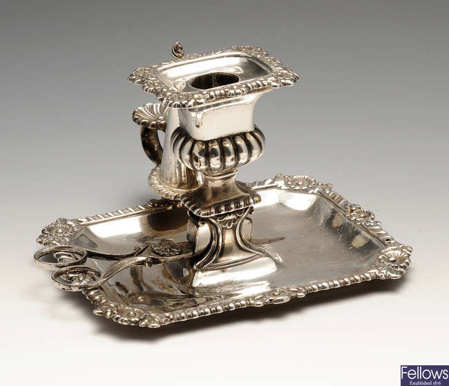 A George IV silver chamberstick.