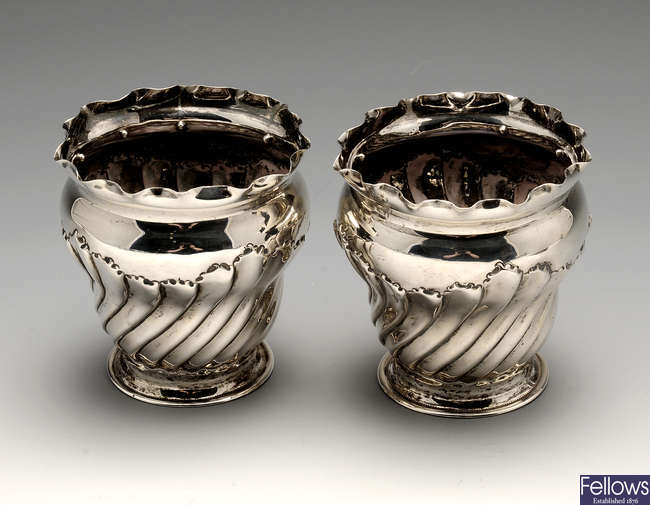 A pair of late Victorian silver fern pots or vases.