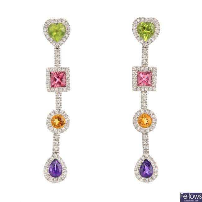 A pair of diamond and gem-set earrings.