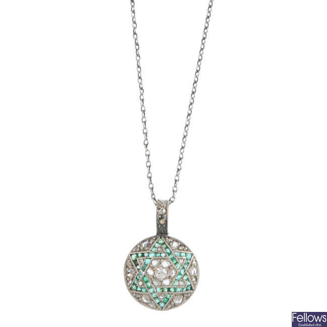 An early 20th century diamond and emerald pendant, with chain.