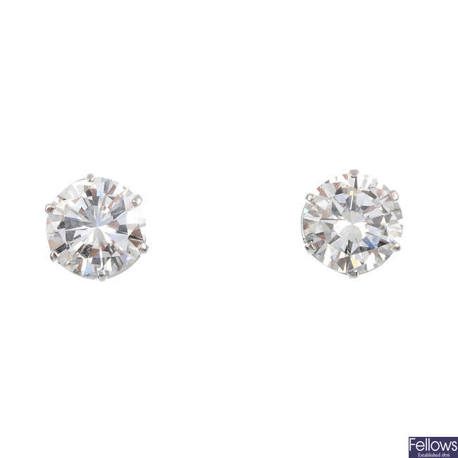 A pair of brilliant-cut diamond single-stone stud earrings.