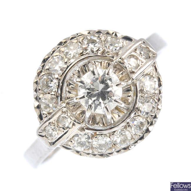 A diamond cluster dress ring.