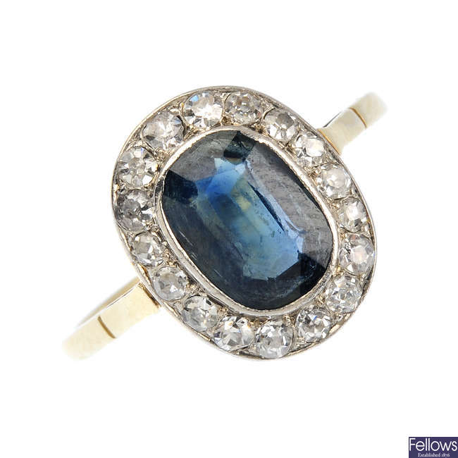 An early 20th century gold sapphire and diamond cluster ring.