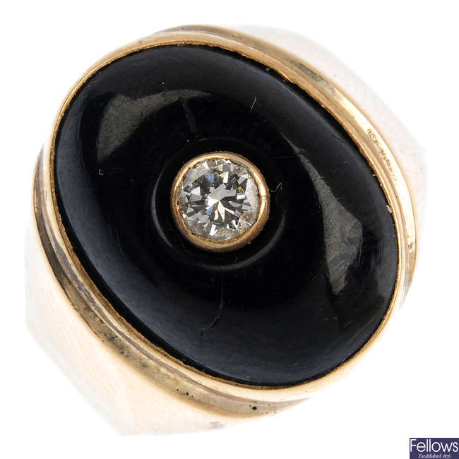 A 14ct gold onyx and diamond signet ring.