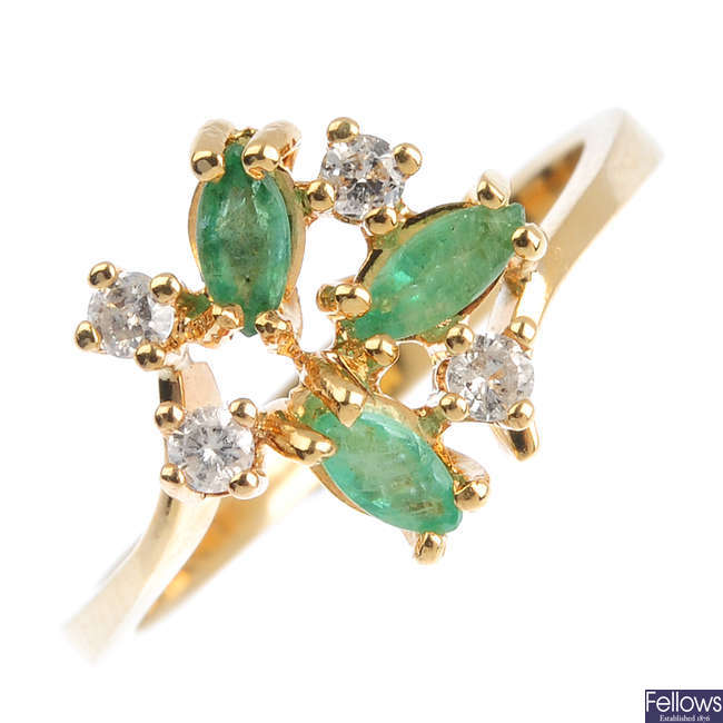 An 14ct gold emerald and diamond dress ring.