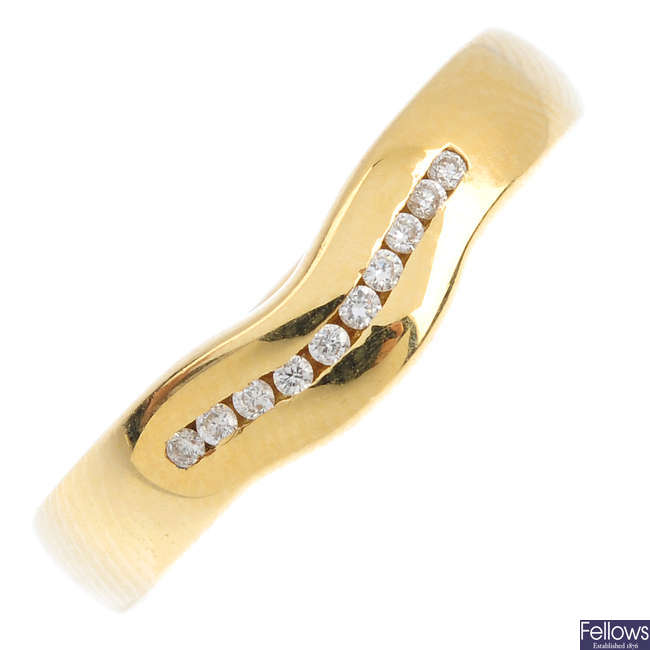 An 18ct gold diamond band ring.