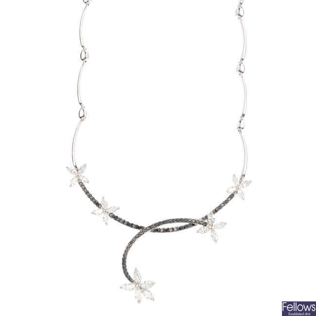 An 18ct gold diamond and gem-set necklace.