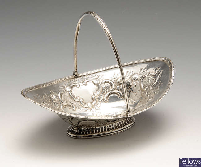 A George III or IV silver sweetmeat basket with swing handle.