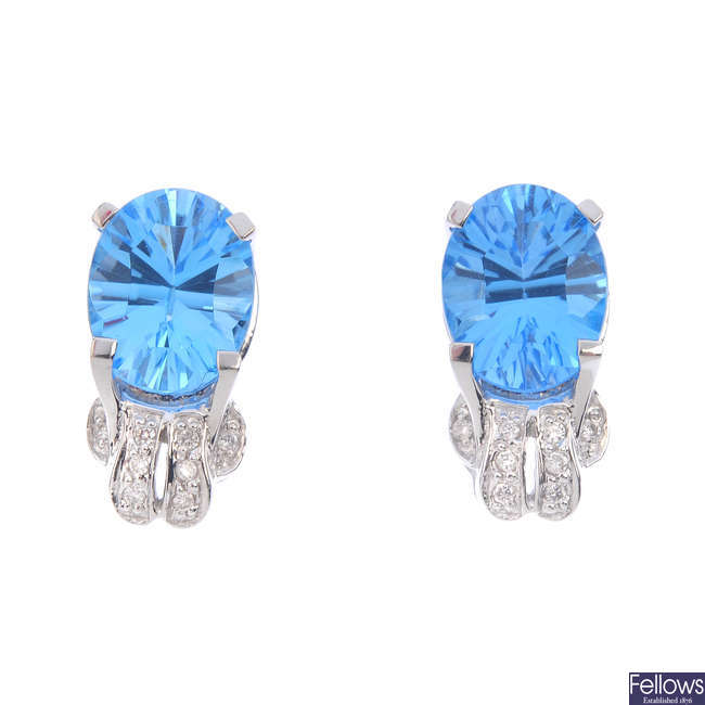 A pair of 18ct gold topaz and diamond earrings.