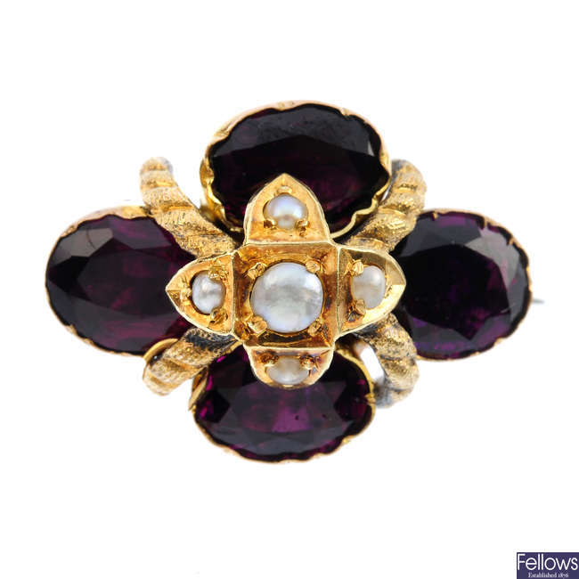 A late Victorian split pearl and garnet brooch.
