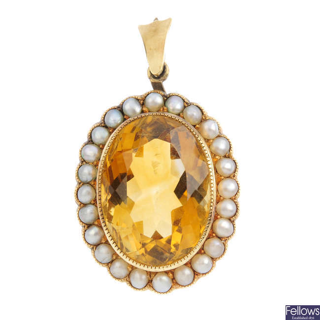 A late Victorian 15ct gold citrine and split pearl pendant.