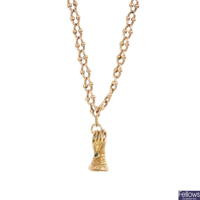 A chain and 9ct gold charm.
