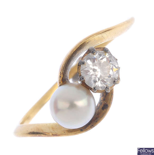 A diamond and natural pearl crossover ring.