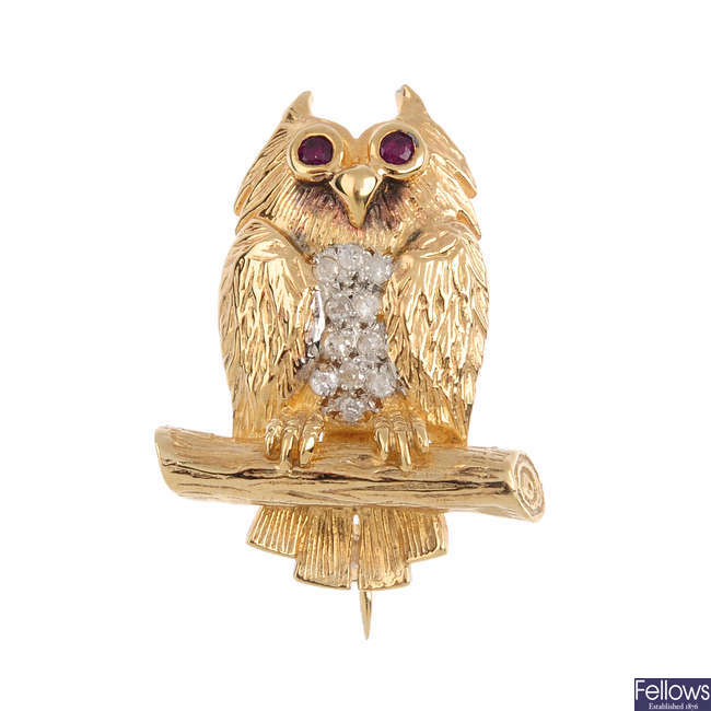 A 9ct gold diamond and ruby owl brooch.