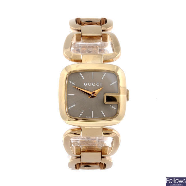 GUCCI - a lady's gold plated 125.5 bracelet watch together with a Gucci wrist watch