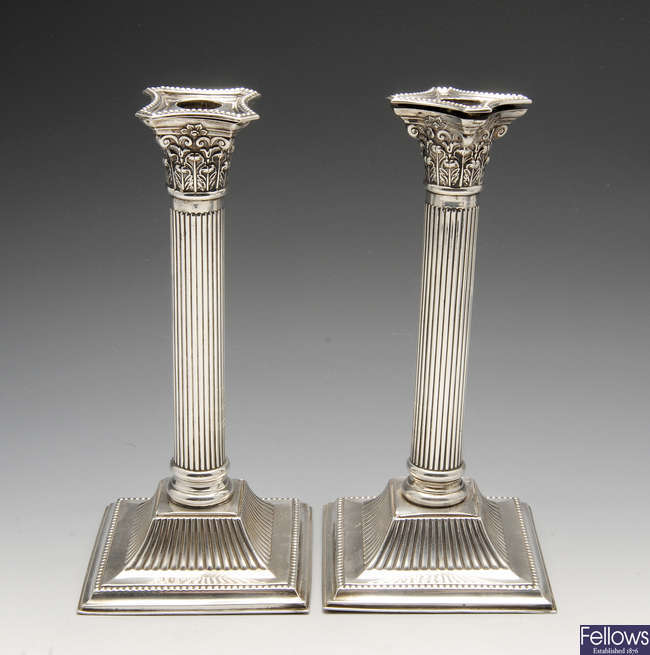 An early twentieth century pair of matched silver mounted candlesticks.