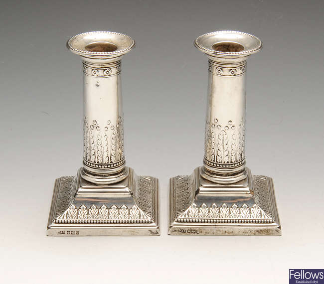 An early twentieth century pair of silver mounted candlesticks.