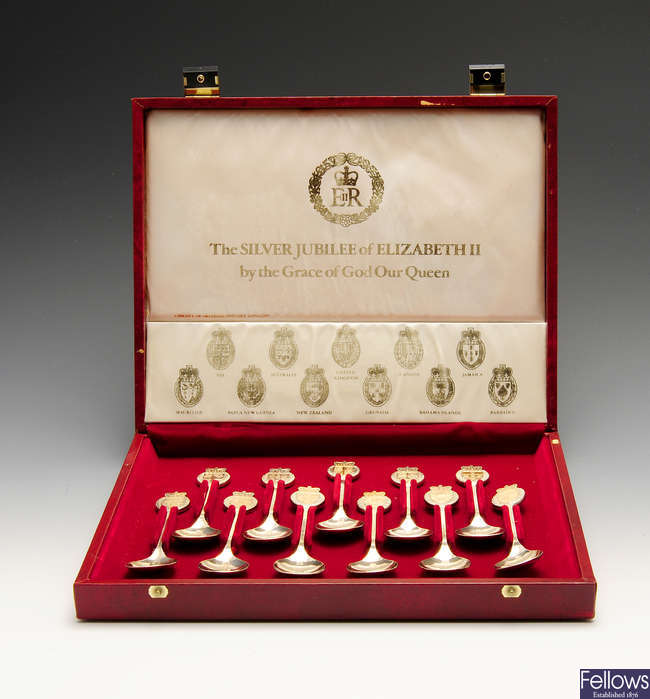 A modern cased set of eleven silver teaspoons commemorating the Silver Jubilee of Elizabeth II, etc.
