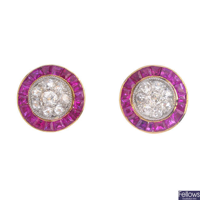 A pair of diamond and synthetic ruby earrings.