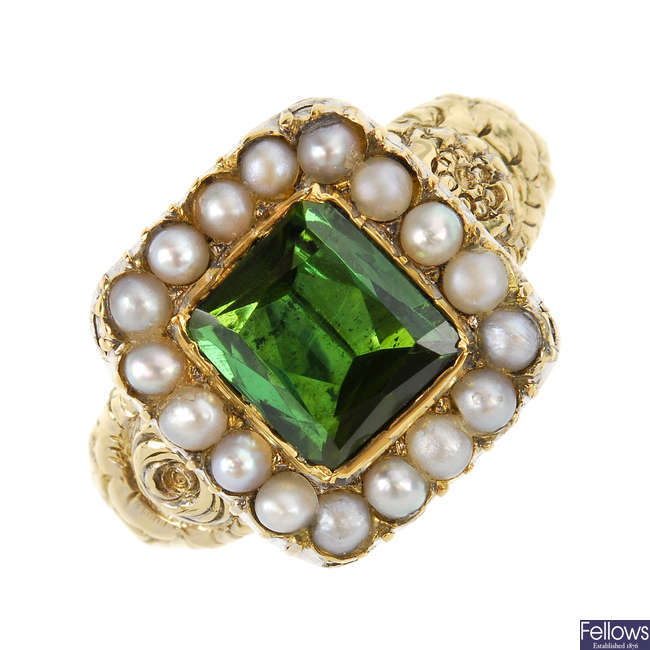 An early Victorian 15ct gold, foil back tourmaline and split pearl ring.