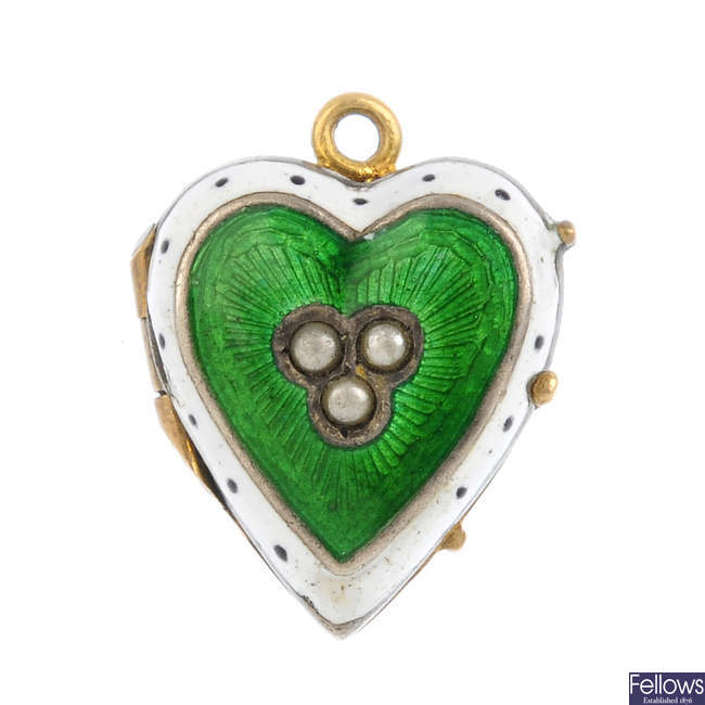 A late Victorian silver and gold enamel heart locket.