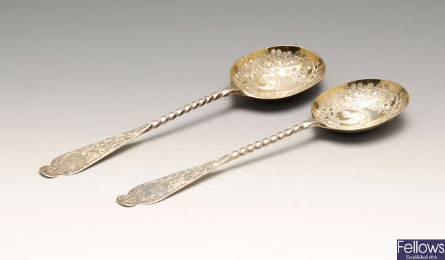 A pair of late Victorian silver fruit serving spoons, etc.