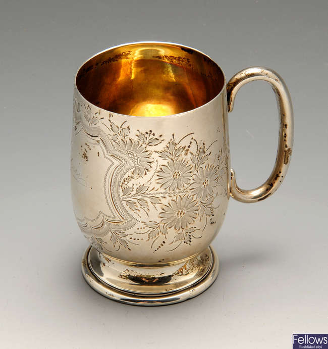 An Edwardian silver christening mug.