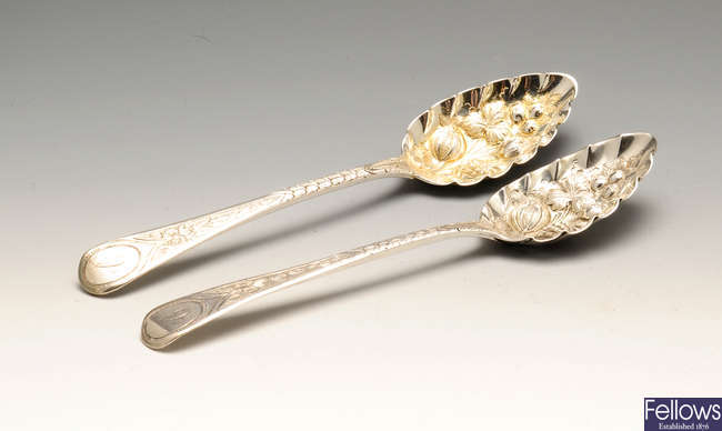 A pair of George III silver berry spoons, etc.