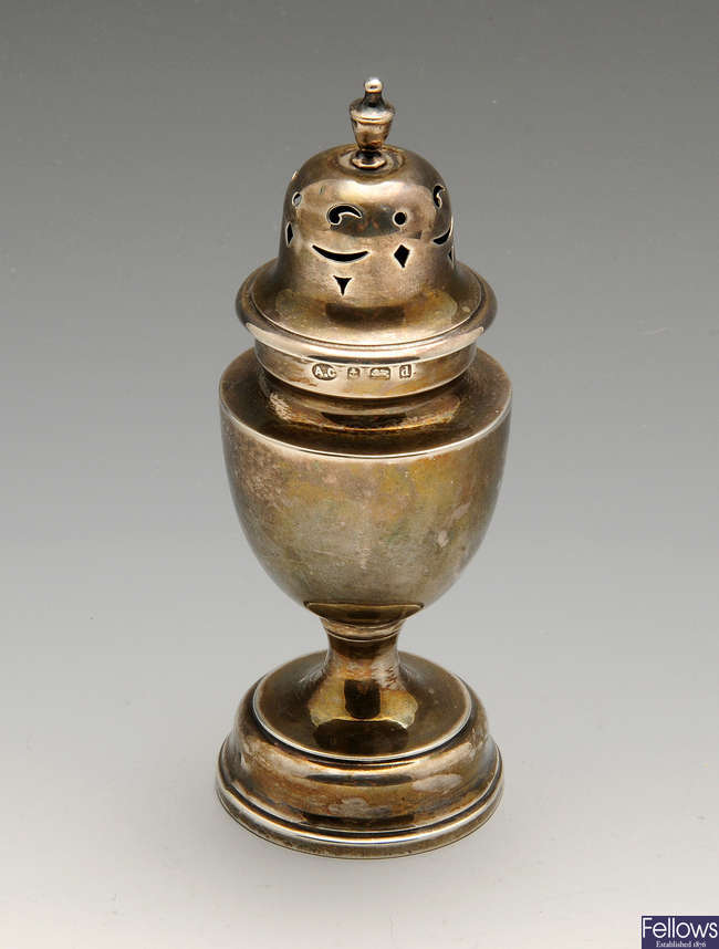 An Edwardian silver caster, a 1920's silver christening mug, etc.