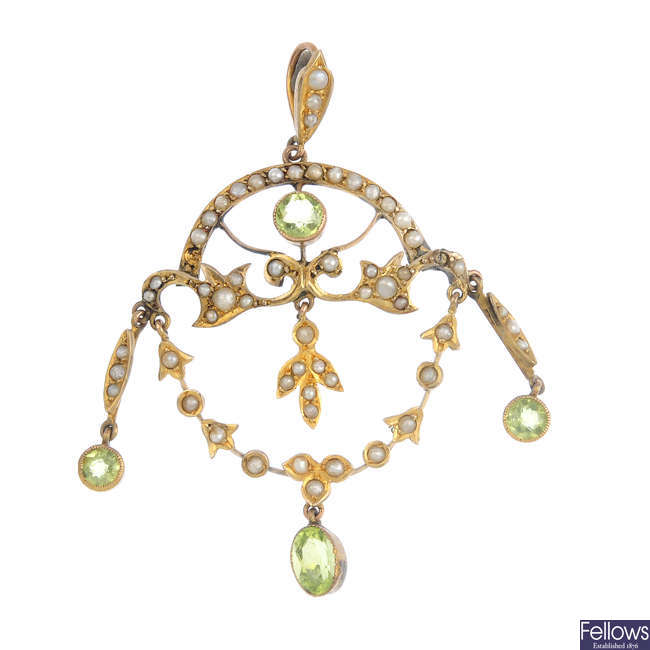 An Edwardian 9ct gold peridot and seed pearl pendant.