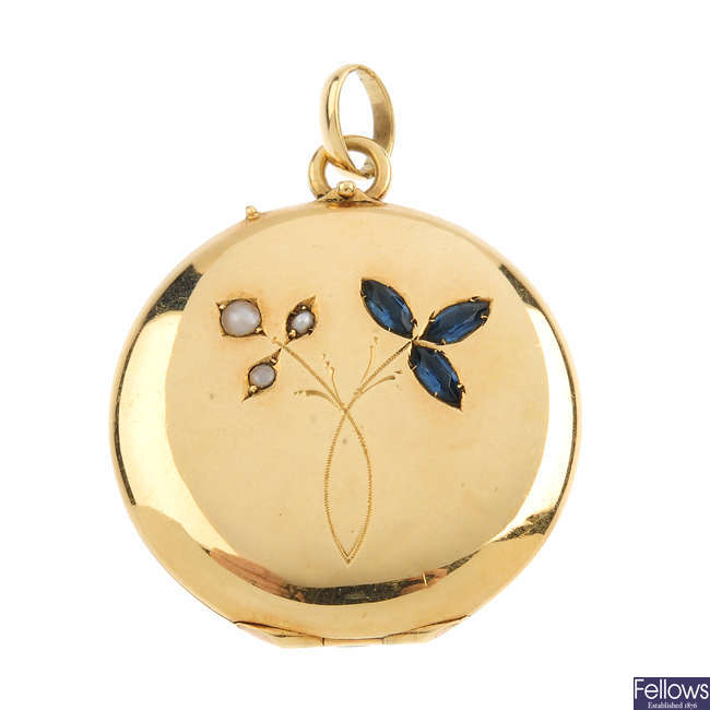 An early 20th century gold split pearl and sapphire locket.