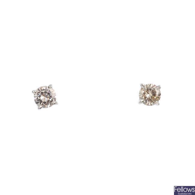 A pair of 18ct gold brilliant-cut diamond single-stone stud earrings.