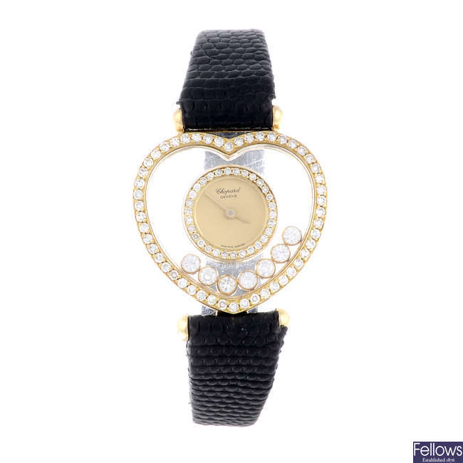 CHOPARD - a lady's factory diamond set yellow metal Happy Diamonds wrist watch.