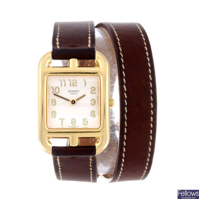 HERMÈS - a lady's 18ct yellow gold Cape Cod wrist watch.