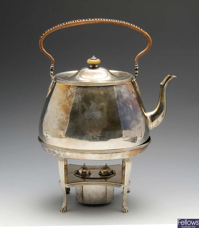 A George III silver tea kettle on stand.