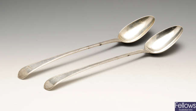 A pair of early George III silver basting spoons.