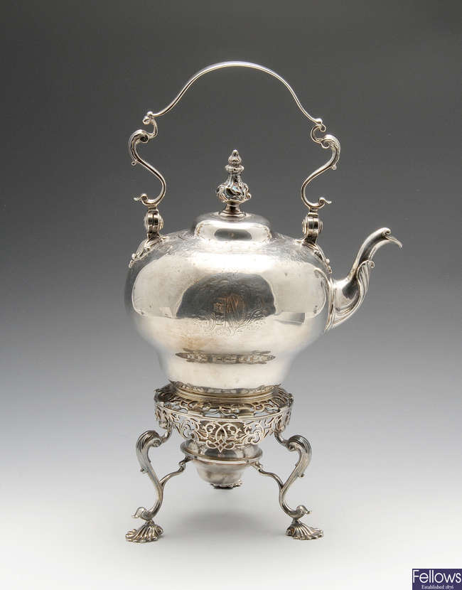 A George II silver tea kettle on stand.