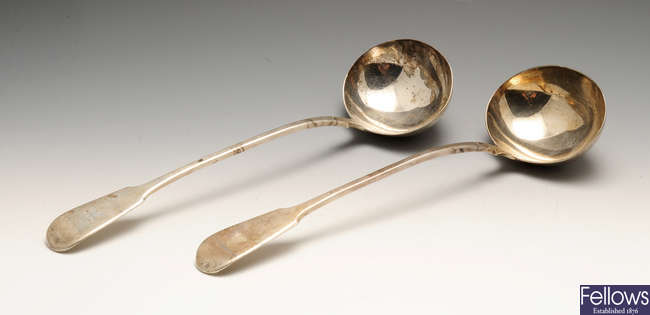 A pair of George IV silver Fiddle pattern soup ladles.