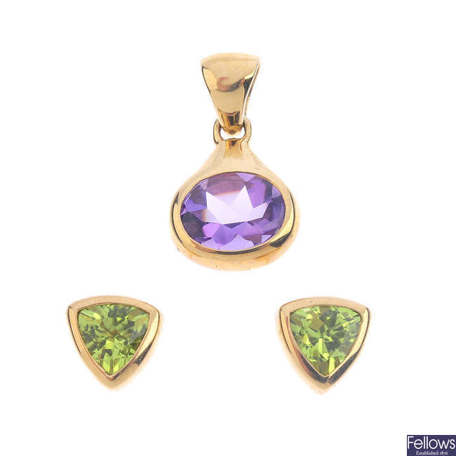 A 9ct gold amethyst pendant and a pair of 9ct gold peridot stud earrings.