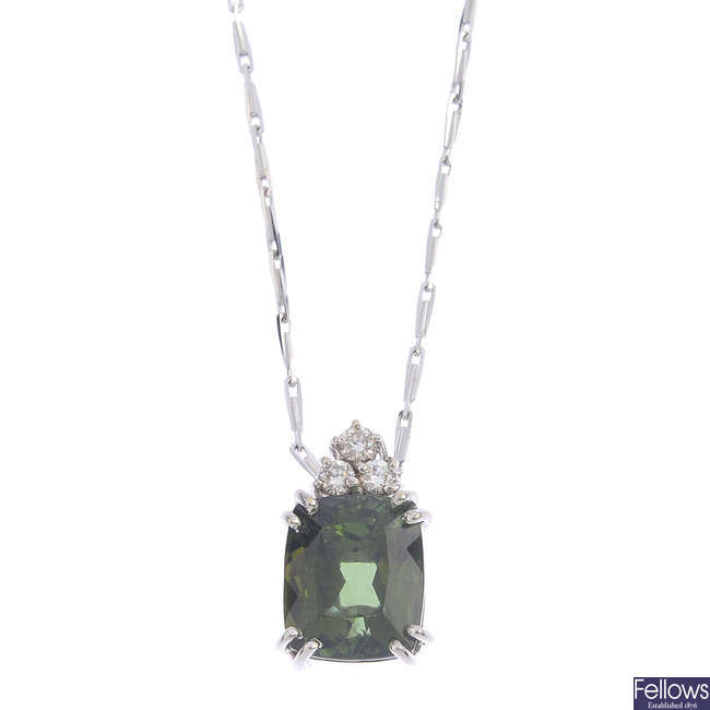 An 18ct gold tourmaline and diamond pendant, with chain.