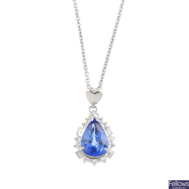 A sapphire and diamond pendant, with chain.