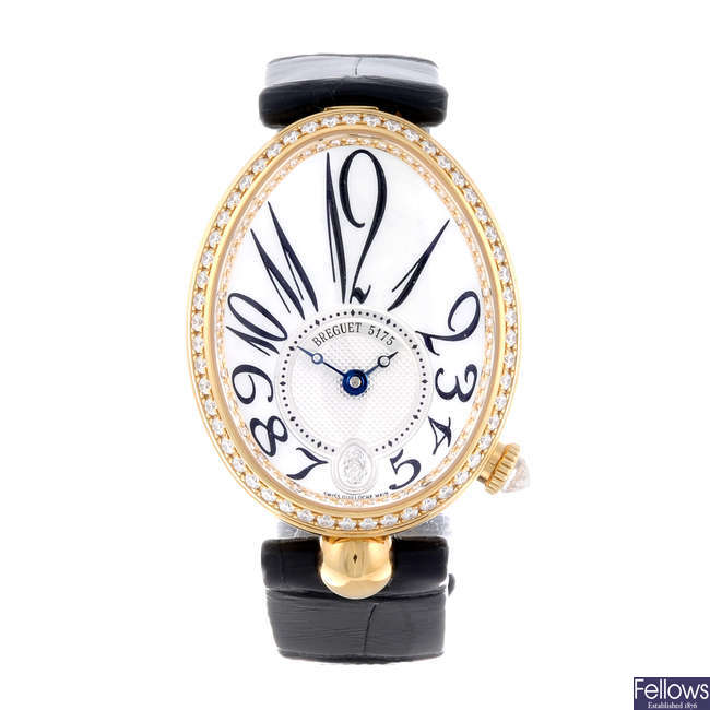BREGUET - a lady's factory diamond set 18ct yellow gold Reine De Naples wrist watch.