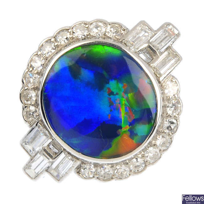 A black opal and diamond cluster ring.
