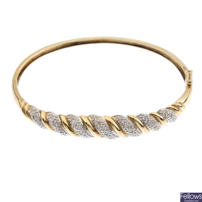 A diamond hinged bangle.