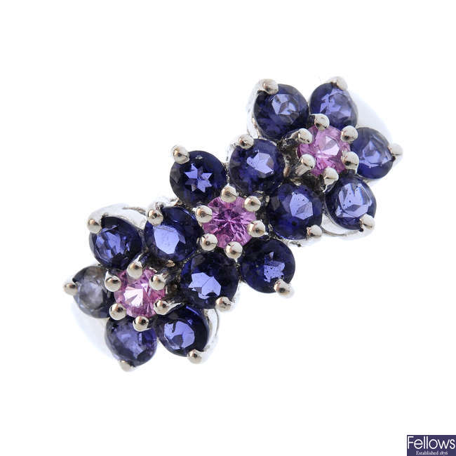 A 14ct gold amethyst and sapphire triple cluster ring.