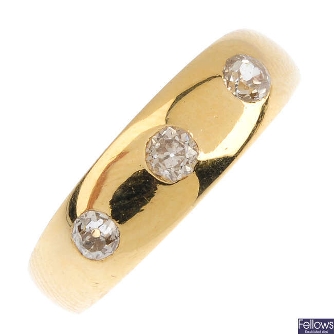An early 20th century 18ct gold diamond three-stone ring.